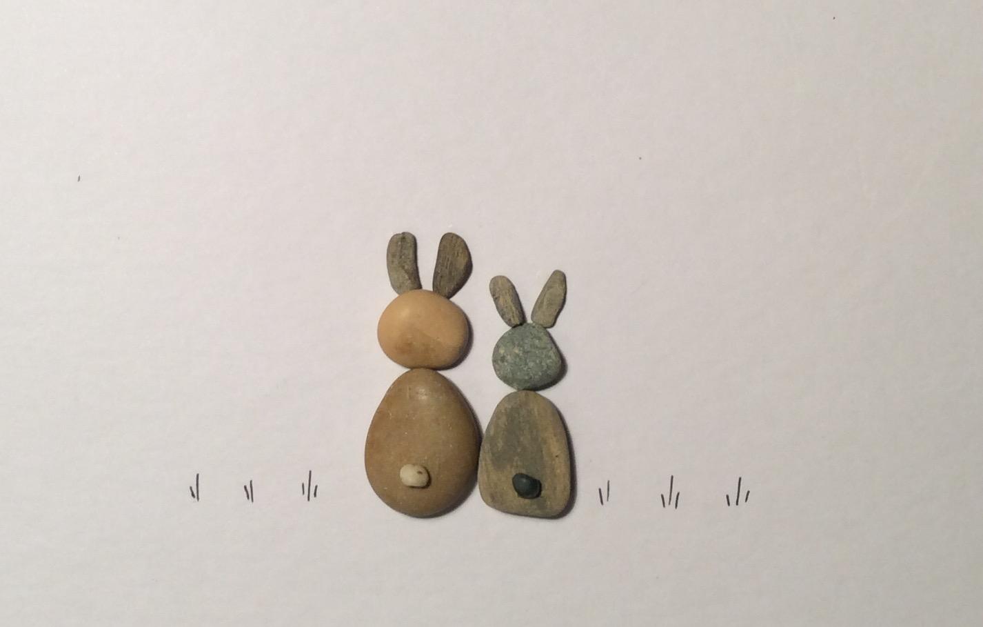Rabbits pebble art close